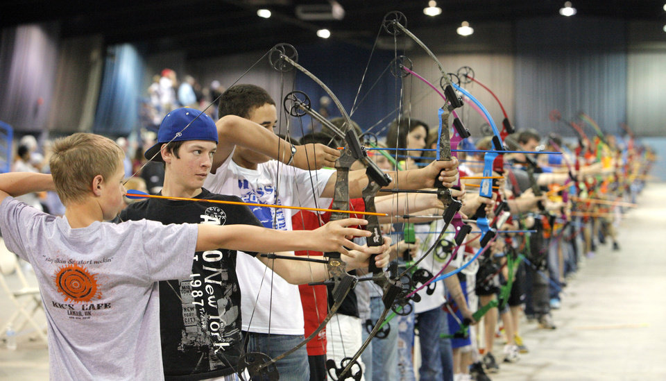 Photo - Students shooting in the 15 meter during the Oklahoma's National Archery in the Schools Program State Shoot at State Fair Park in Oklahoma City Wednesday, March 28, 2012. Photo by Paul B. Southerland, The Oklahoman