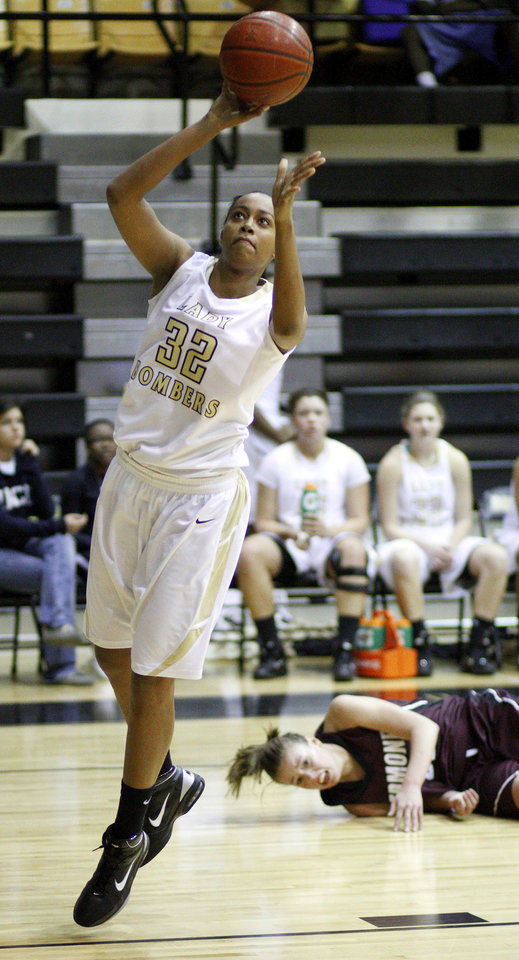 Photo - Midwest City's Carolee Dillard goes to the basket past Edmond Memorial's Alie Decker during a girls high school basketball game in Midwest City, Okla., Tuesday, December 7, 2010.  Photo by Bryan Terry, The Oklahoman ORG XMIT: KOD