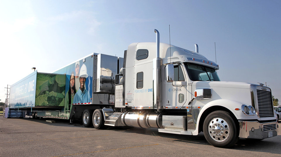 "ONEOK's  ""Powered by One"" exhibit truck and trailer are shown at Oklahoma City Community College.  Photo by David McDaniel, The Oklahoman <strong>David McDaniel</strong>"