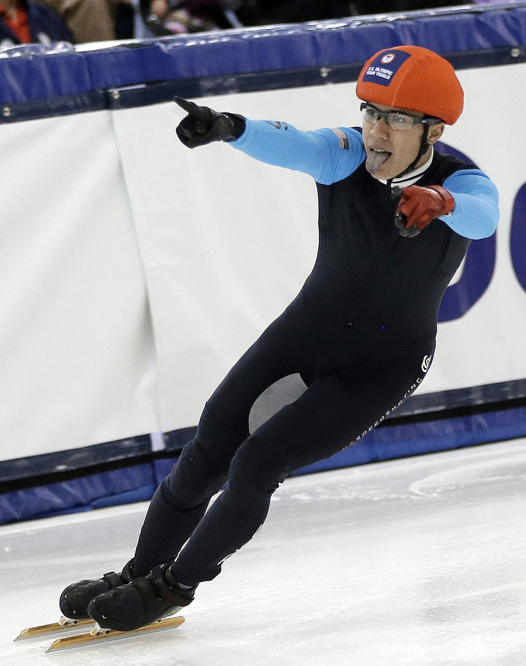 Photo - J.R. Celski reacts to the crowd after a race in the men's 1,500 meters during the U.S. Olympic short track speedskating trials Friday, Jan. 3, 2014, in Kearns, Utah. (AP Photo/Rick Bowmer)