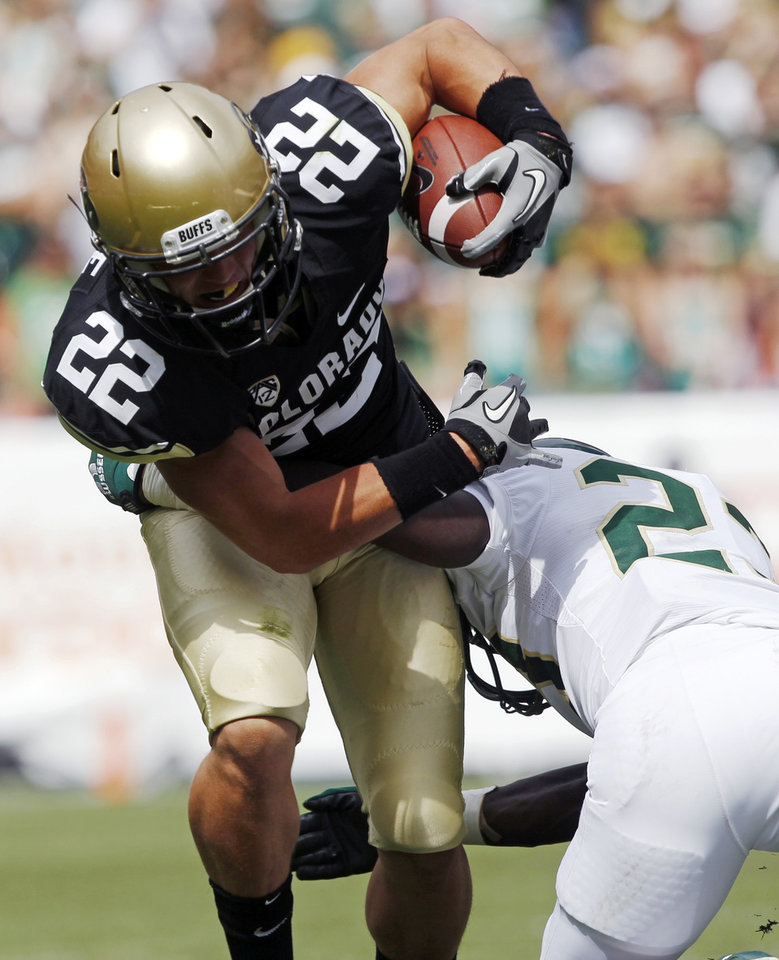 Photo -   Colorado wide receiver Nelson Spruce, left, is tackled by Colorado State defensive back Bernard Blake in the second quarter of an NCAA college football game in Denver on Saturday, Sept. 1, 2012. (AP Photo/David Zalubowski)