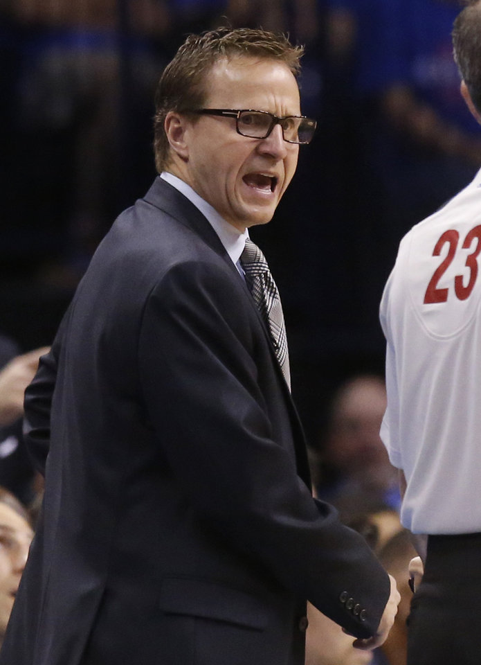Photo - Oklahoma City Thunder head coach Scott Brooks shouts to an official in the third quarter of Game 1 of the Western Conference semifinal NBA basketball playoff series against the Los Angeles Clippers in Oklahoma City, Monday, May 5, 2014. Los Angeles won 122-105. (AP Photo/Sue Ogrocki)