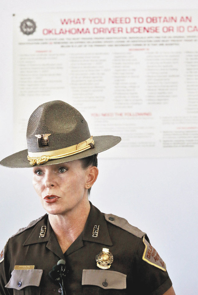 Photo -  Oklahoma Highway Patrol trooper Betsy Randolph speaks to the media about the closing of the Yukon driver's license testing office.    Photo by Chris Landsberger, The Oklahoman  CHRIS LANDSBERGER - CHRIS LANDSBERGER
