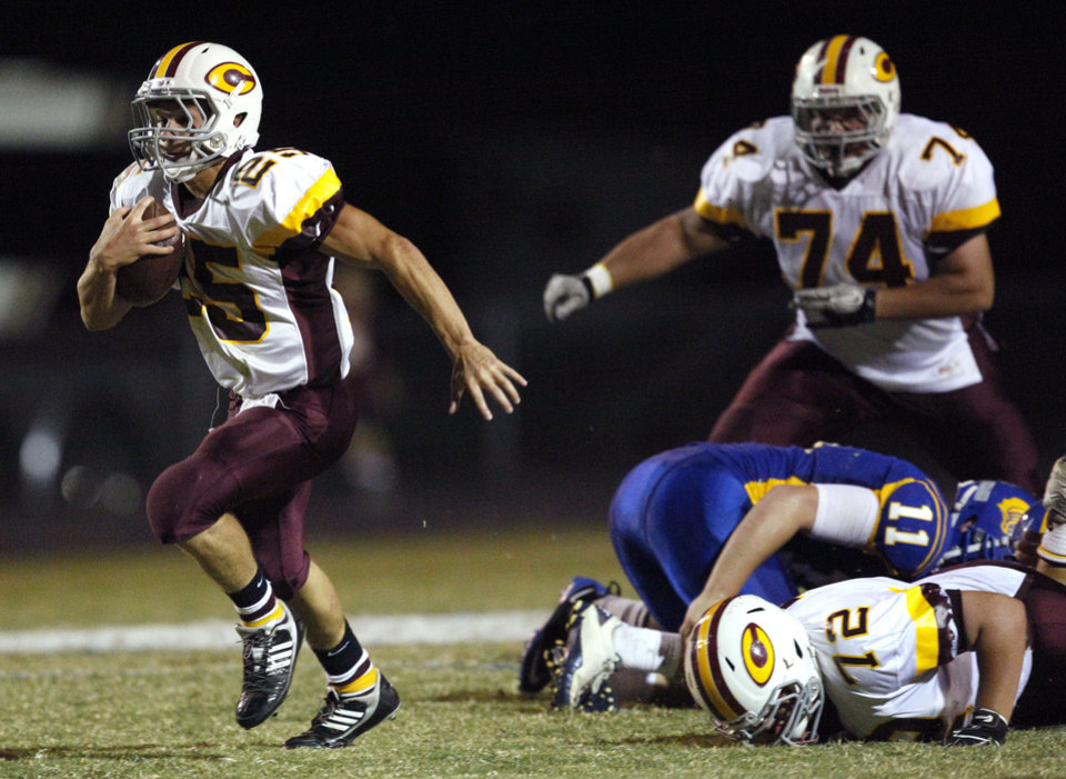 Clinton\'s Trey McKinsey gets by the Piedmont defense during the high school football game between Piedmont and Clinton in Piedmont, Okla., Friday, Sept. 30, 2011. Photo by Sarah Phipps, The Oklahoman ORG XMIT: KOD