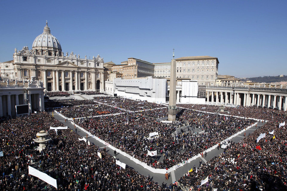 Thousands flocked to St. Peter's Square on Wednesay for Pope Benedict XVI's last general audience. AP PHOTO