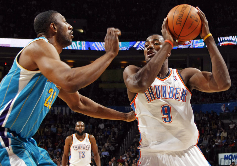 Oklahoma City's Serge Ibaka (9) tries to get the ball past Didier Ilunga-Mbenga (28) of New Orleans during the NBA basketball game between the New Orleans Hornets and the Oklahoma City Thunder at the Oklahoma City Arena in downtown Oklahoma City, Monday, Nov. 29, 2010. Photo by Nate Billings, The Oklahoman