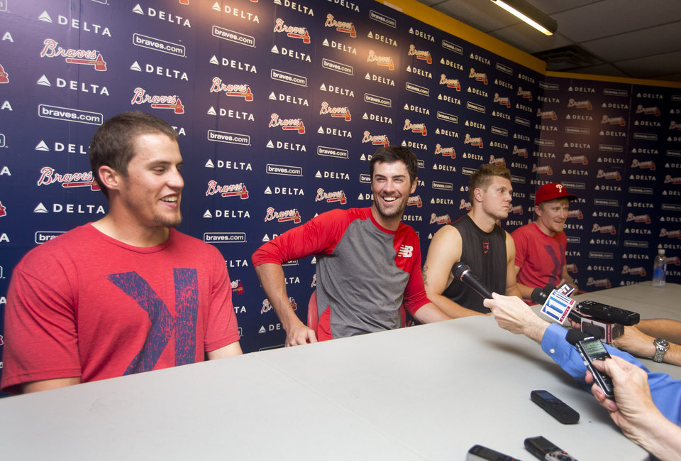Photo - Philadelphia Phillies pitchers from left; Ken Giles, Cole Hamels, Jonathan Papelbon  and  Jake Diekman  joke during a news conference after they combined efforts for a no-hitter against the Atlanta Braves  in  baseball game Monday, Sept. 1, 2014, in Atlanta. Philadelphia won 7-0. (AP Photo/John Bazemore)