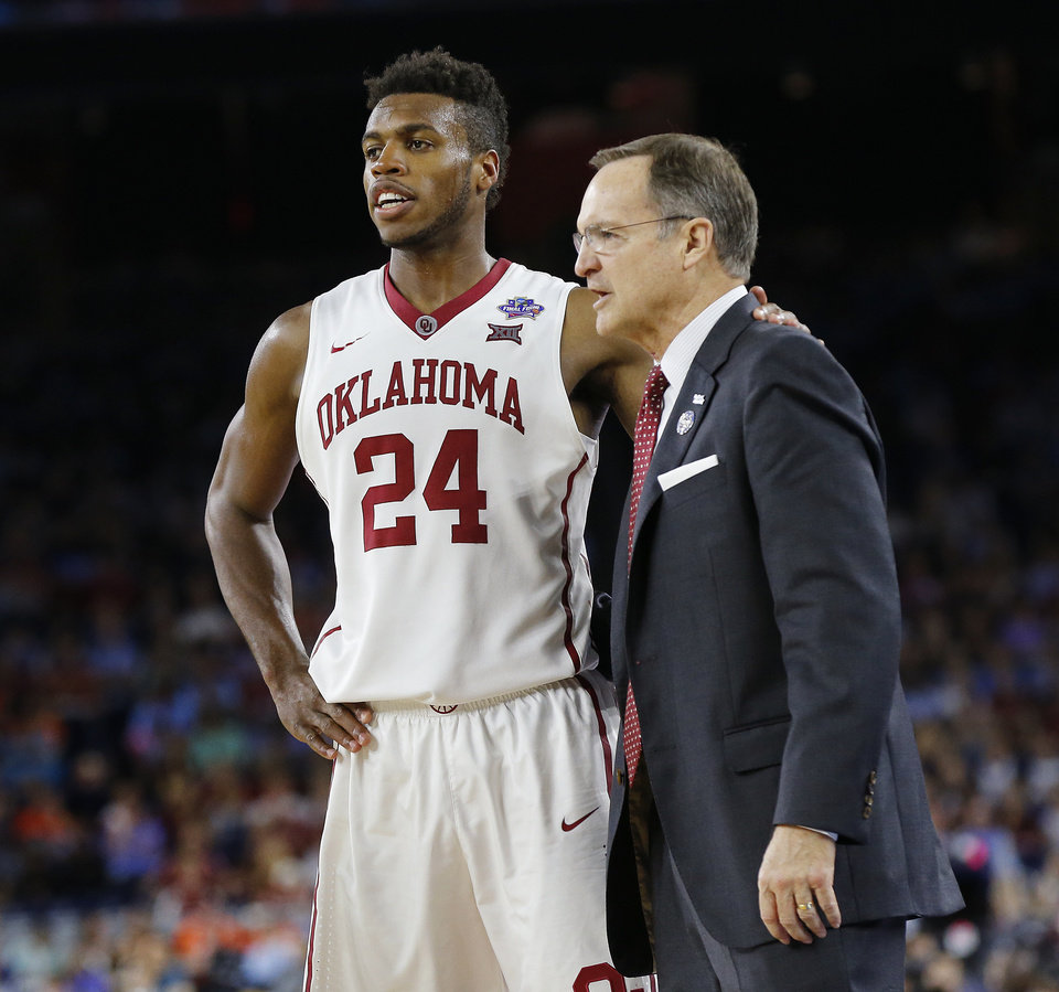 Photo - Oklahoma coach Lon Kruger talks with Buddy Hield (24) during the national semifinal between the Oklahoma Sooners (OU) and the Villanova Wildcats in the Final Four of the NCAA Men's Basketball Championship at NRG Stadium in Houston, Saturday, April 2, 2016. Photo by Nate Billings, The Oklahoman