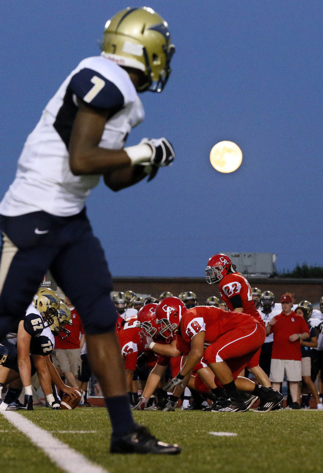 Photo - Jalen Adams (7) and the Southmoore Sabercats line up against Carl Albert under a blue moon during a high school football game between Carl Albert and Southmoore in Midwest City, Okla., Friday, Aug. 31, 2012. Photo by Nate Billings, The Oklahoman