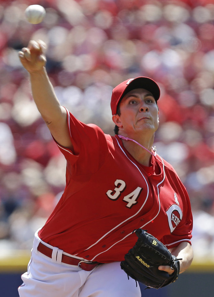 Photo - Cincinnati Reds starting pitcher Homer Bailey throws against the Colorado Rockies in the first inning of a baseball game, Sunday, May 11, 2014, in Cincinnati. (AP Photo/Al Behrman)