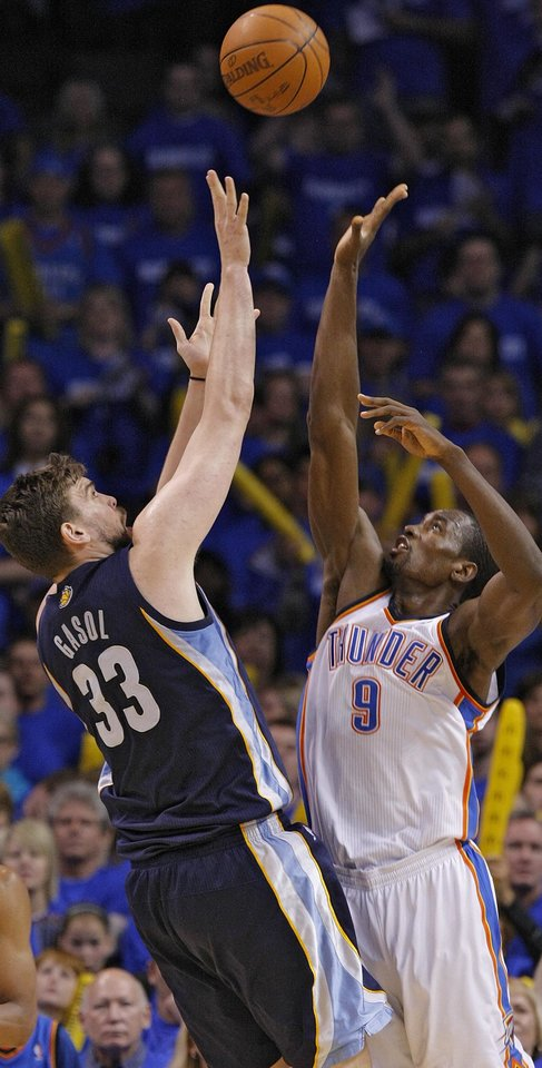 Memphis' Marc Gasol (33) shoots  against Oklahoma City Serge Ibaka (9) during game one of the Western Conference semifinals between the Memphis Grizzlies and the Oklahoma City Thunder in the NBA basketball playoffs at Oklahoma City Arena in Oklahoma City, Sunday, May 1, 2011. Photo by Chris Landsberger, The Oklahoman