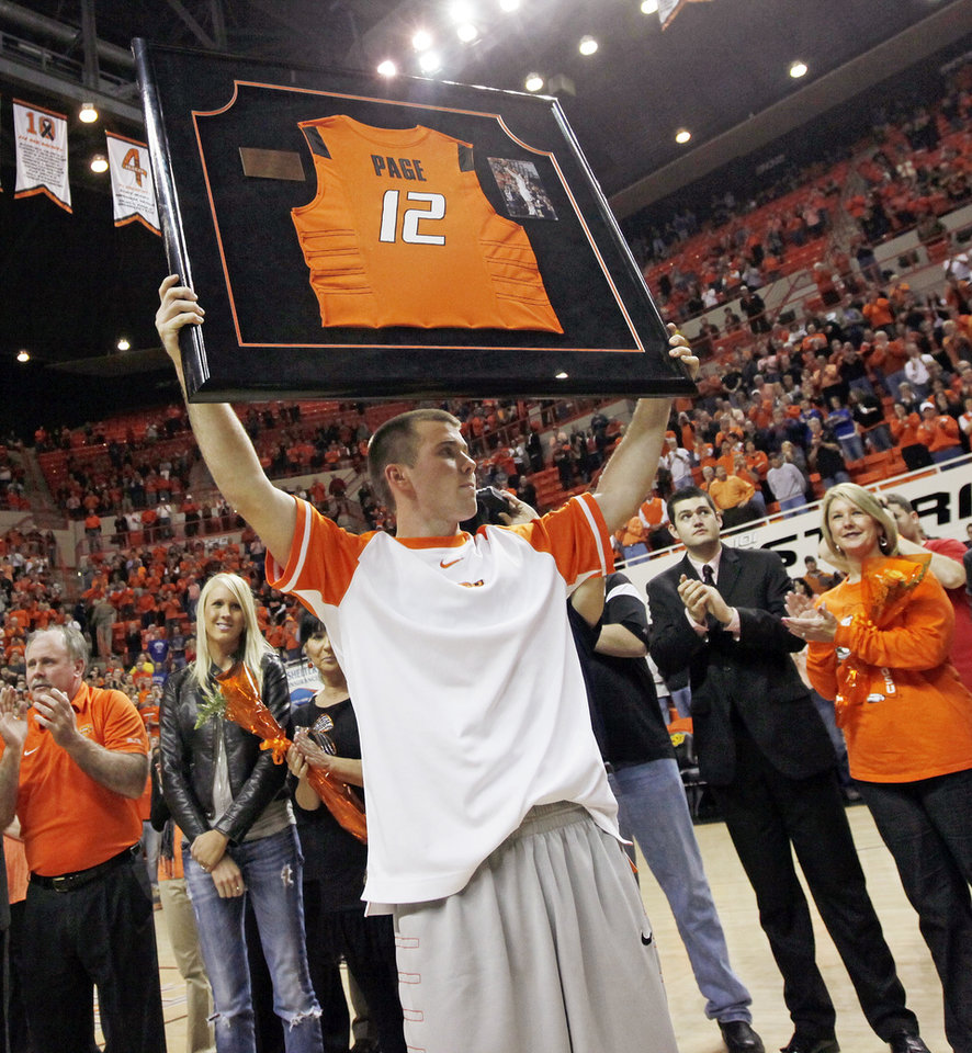 Photo - OSU's Keiton Page holds up his framed jersey during senior day before a men's college basketball game between the Oklahoma State University Cowboys and the University of Kansas Jayhawks at Gallagher-Iba Arena in Stillwater, Okla., Monday, Feb. 27, 2012. Photo by Nate Billings, The Oklahoman