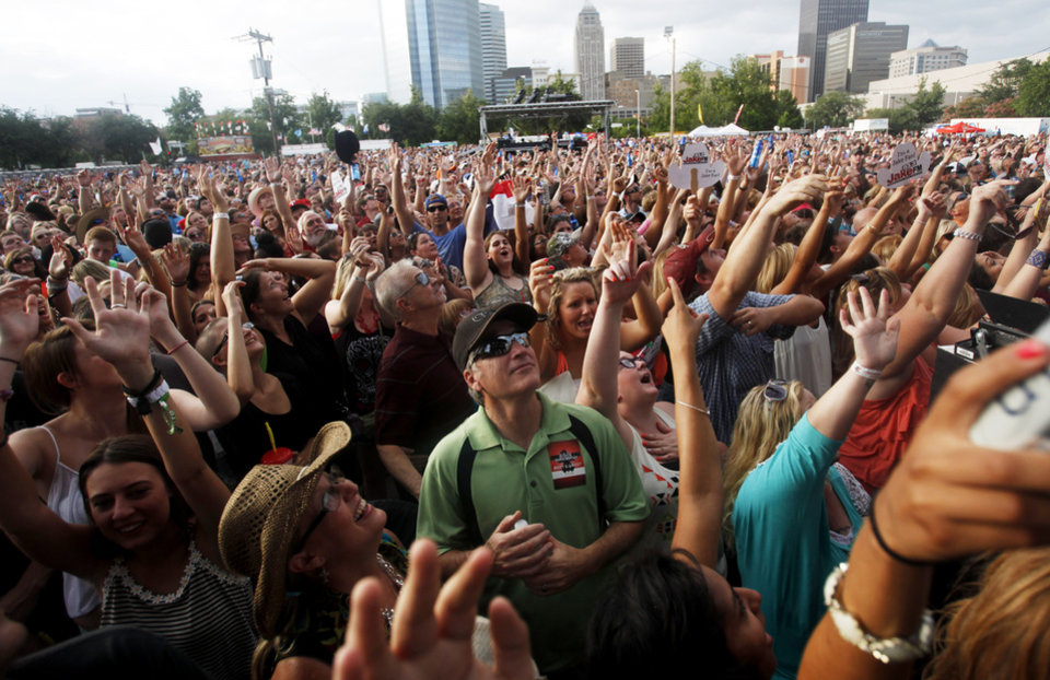 Photo - The crowd at OKC Fest reacts to Josh Abbott of Josh Abbott Band as he performs at OKC Fest in downtown Oklahoma City on Friday, June 27, 2014. OKC Fest is a new two day country music festival with multiple stages downtown. Photos by KT King/The Oklahoman