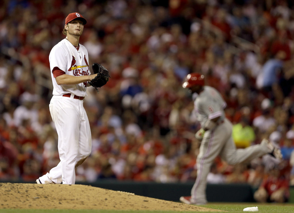 Photo - Philadelphia Phillies' Ryan Howard, right, rounds the bases after hitting a two-run home run off St. Louis Cardinals starting pitcher Shelby Miller, left, during the sixth inning of a baseball game on Thursday, June 19, 2014, in St. Louis. (AP Photo/Jeff Roberson)