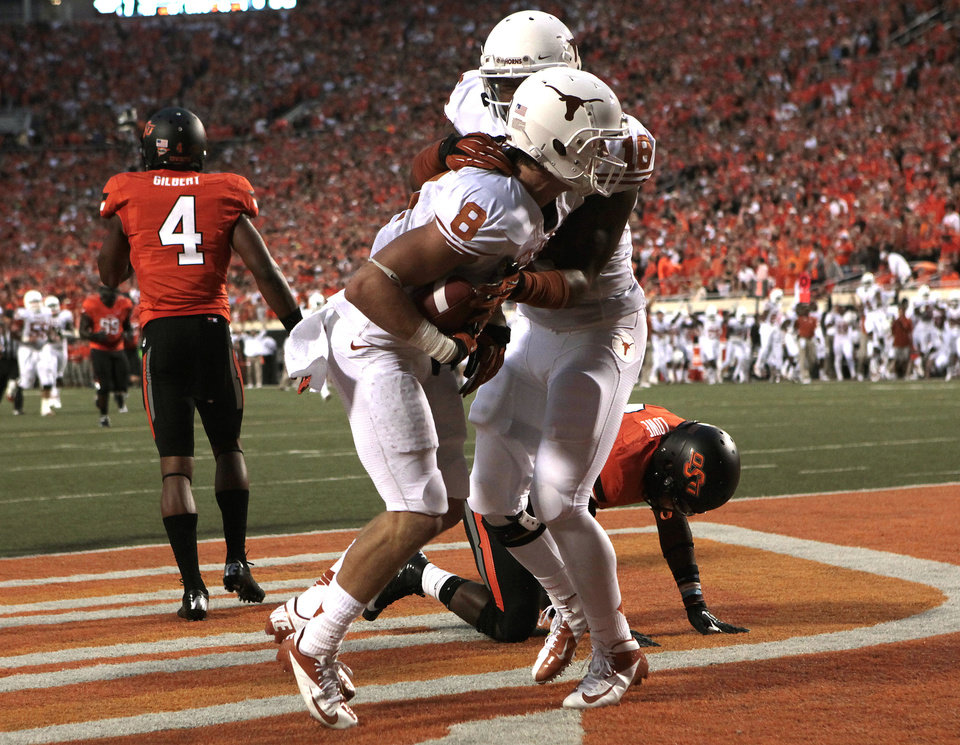 Photo - Texas Jaxon Shipley (8) and D.J. Grant (18) celebrate a touchdown in front of Oklahoma State's Justin Gilbert (4) and Daytawion Lowe (8) during a college football game between Oklahoma State University (OSU) and the University of Texas (UT) at Boone Pickens Stadium in Stillwater, Okla., Saturday, Sept. 29, 2012. Photo by Sarah Phipps, The Oklahoman