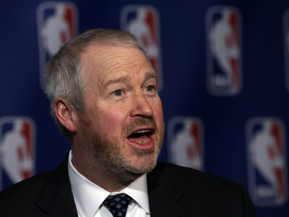 Photo - Seattle Mayor Michael McGinn is interviewed after his meeting with the NBA regarding the possible relocation of the Sacramento Kings basketball team to Seattle, in New York, Wednesday, April 3, 2013. Hedge fund manager Chris Hansen and Microsoft Chief Executive Steve Ballmer have agreed to buy a majority stake in the Kings from the Maloof family for $341 million, but the deal needs league approval. (AP Photo/Richard Drew)