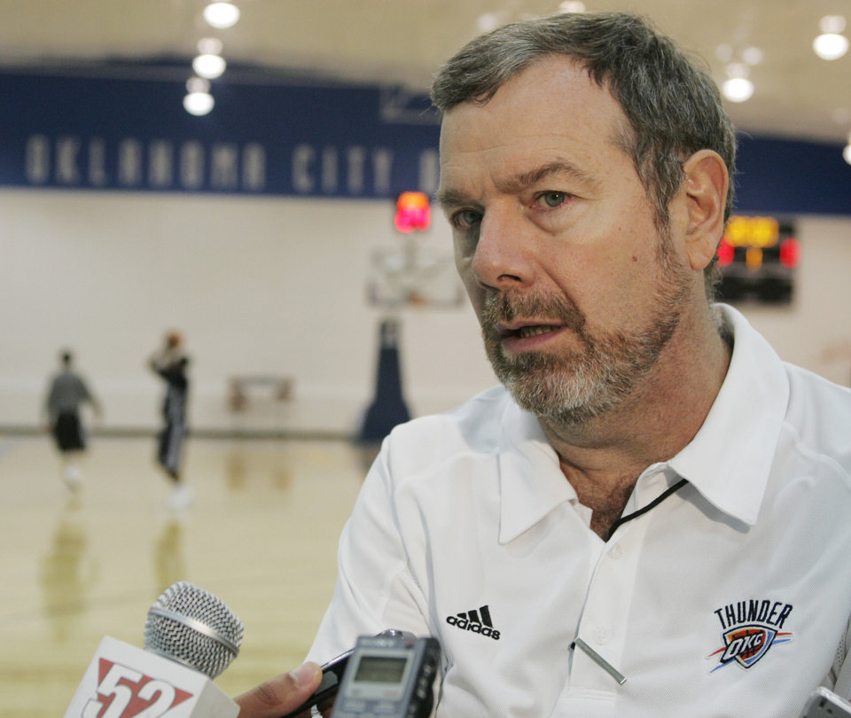 Photo - Oklahoma City Thunder NBA basketball head coach P.J. Carlesimo talks with the media following a team practice in Oklahoma City, Monday, Oct. 6, 2008. After spending the offseason relocating from Seattle, the preseason scheduled hardly gives the former SuperSonics a chance to be at home. They'll start a road trip Wednesday night against Minnesota in Billings, Mont., and swing through Sacramento and Golden State before returning to Oklahoma.  (AP Photo/Sue Ogrocki) ORG XMIT: OKSO101