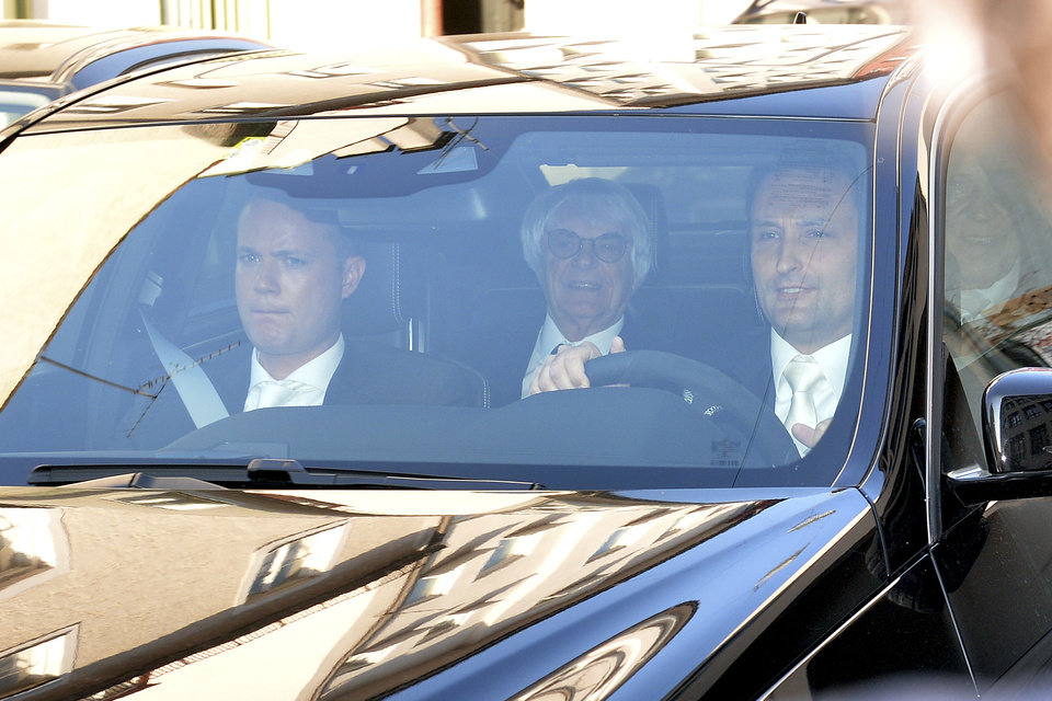Photo - Bernie Ecclestone, center, the 83-year-old controlling business magnate in Formula One racing, sits in a car on his way to the regional court in Munich , Germany, Thurstay, April 24, 2014. Ecclestone is charged with bribery and incitement to breach of trust