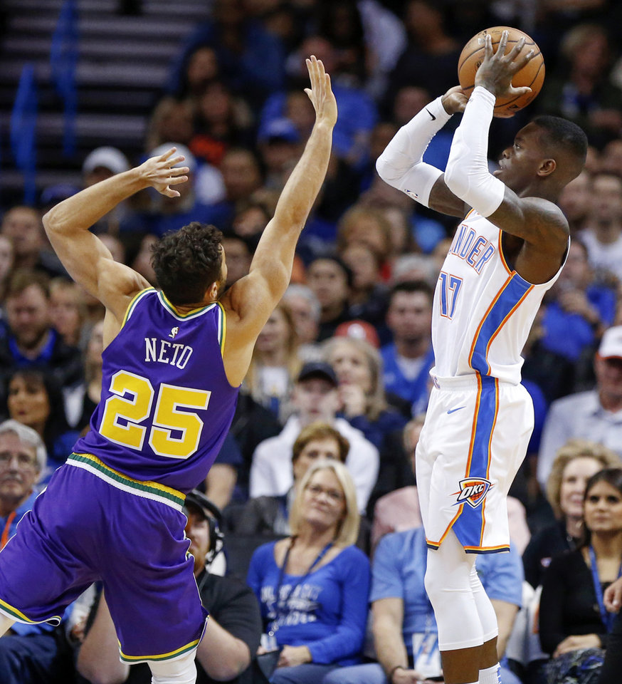 Photo - Oklahoma City's Dennis Schroder (17) shoots against Utah's Raul Neto (25) during an NBA basketball game between the Utah Jazz and the Oklahoma City Thunder at Chesapeake Energy Arena in Oklahoma City, Monday, Dec. 10, 2018. Photo by Nate Billings, The Oklahoman