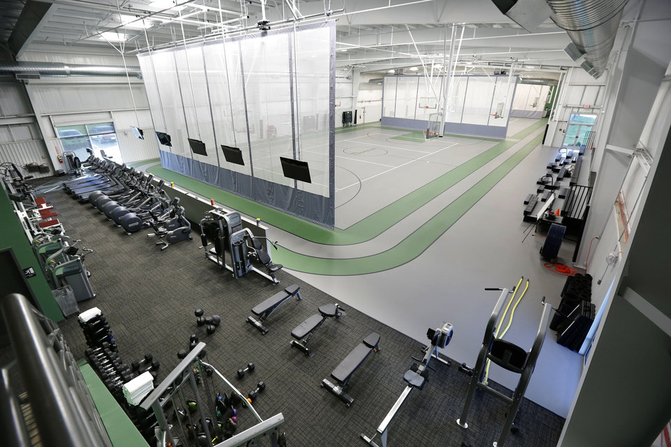 Photo -  Employee amenities at Paycom's campus in northwest Oklahoma City includes a 28,500-square-foot gymnasium. [Oklahoman Archives Photo]
