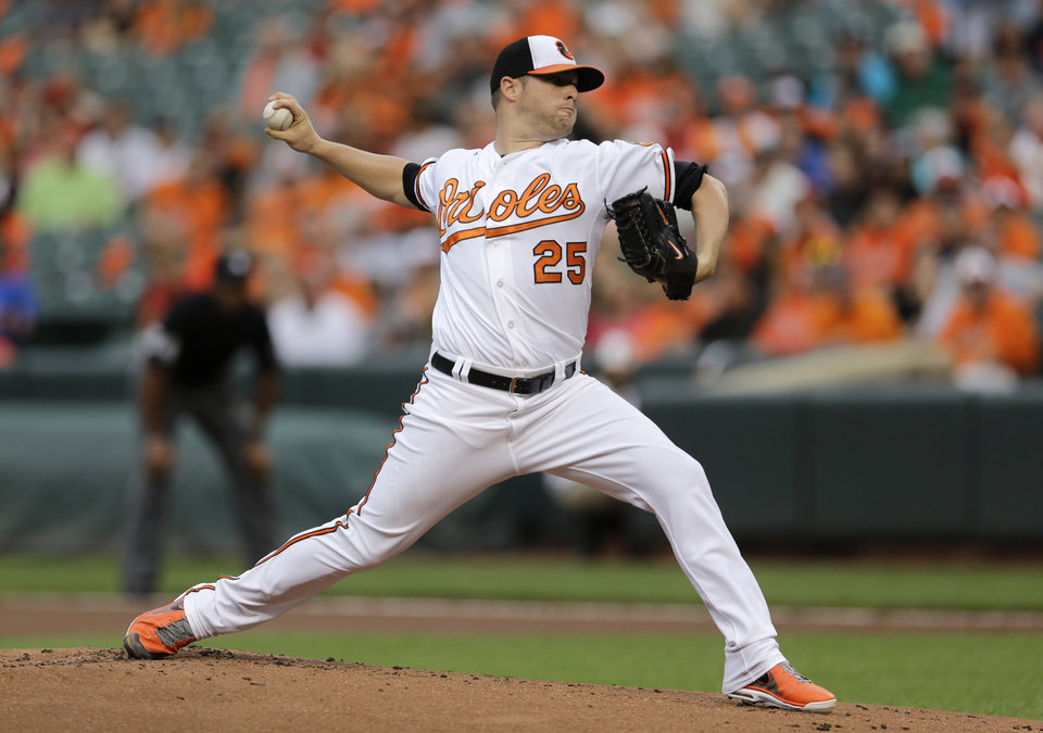 Photo - Baltimore Orioles starting pitcher Bud Norris throws to the Washington Nationals in the first inning of an interleague baseball game, Wednesday, July 9, 2014, in Baltimore. (AP Photo/Patrick Semansky)