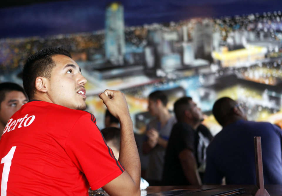 Photo - Roberto Hernandez, originally from Mexico City but now living in Oklahoma City, reacts to a missed chance by the Mexican team during the watch party Tuesday at Medio Tiempo Sports Cantina and Grill.  KT King