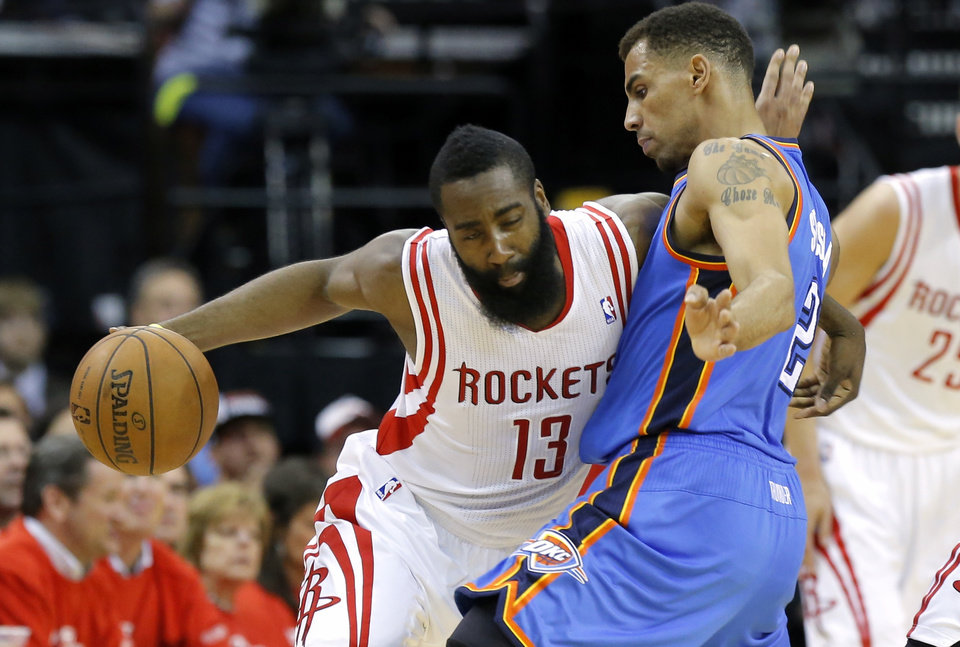 Houston's James Harden tries to get past Oklahoma City's Thabo Sefolosha during Game 4 in the first round of the NBA playoffs between the Oklahoma City Thunder and the Houston Rockets at the Toyota Center in Houston, Texas, Monday, April 29, 2013. Photo by Bryan Terry, The Oklahoman
