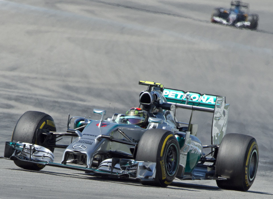 Photo - World Championships leader and Mercedes Formula One driver Nico Rosberg of Germany speeds during the free practice session at the German Formula One Grand Prix in Hockenheim, Germany, Friday, July 18, 2014. The German Grand Prix will be held on Sunday, July 20, 2014. (AP Photo/Jens Meyer)