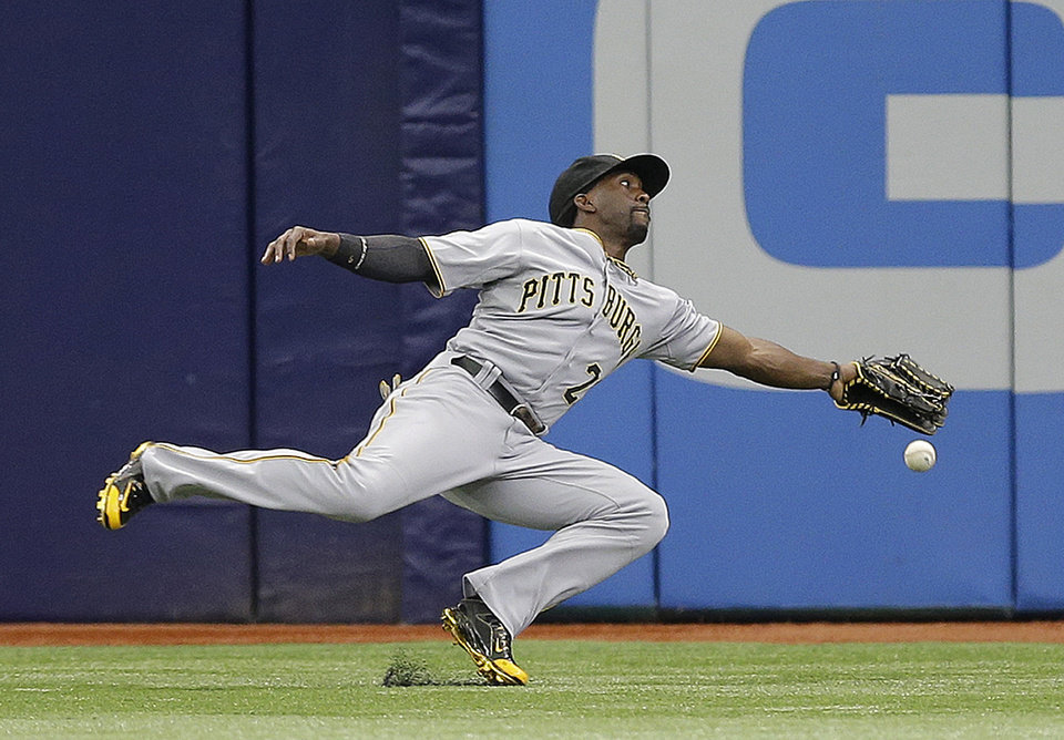 Photo - Pittsburgh Pirates center fielder Andrew McCutchen dives but can't make the catch on a triple by Tampa Bay Rays' Ben Zobrist during the first inning of an interleague baseball game Wednesday, June 25, 2014, in St. Petersburg, Fla. (AP Photo/Chris O'Meara)