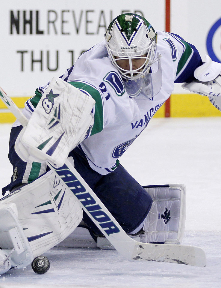 Photo - Vancouver Canucks goaltender Eddie Lack turns away a Winnipeg Jets shot during the second period of an NHL hockey game in Winnipeg, Manitoba, on Friday, Jan. 31, 2014. (AP Photo/The Canadian Press, John Woods)