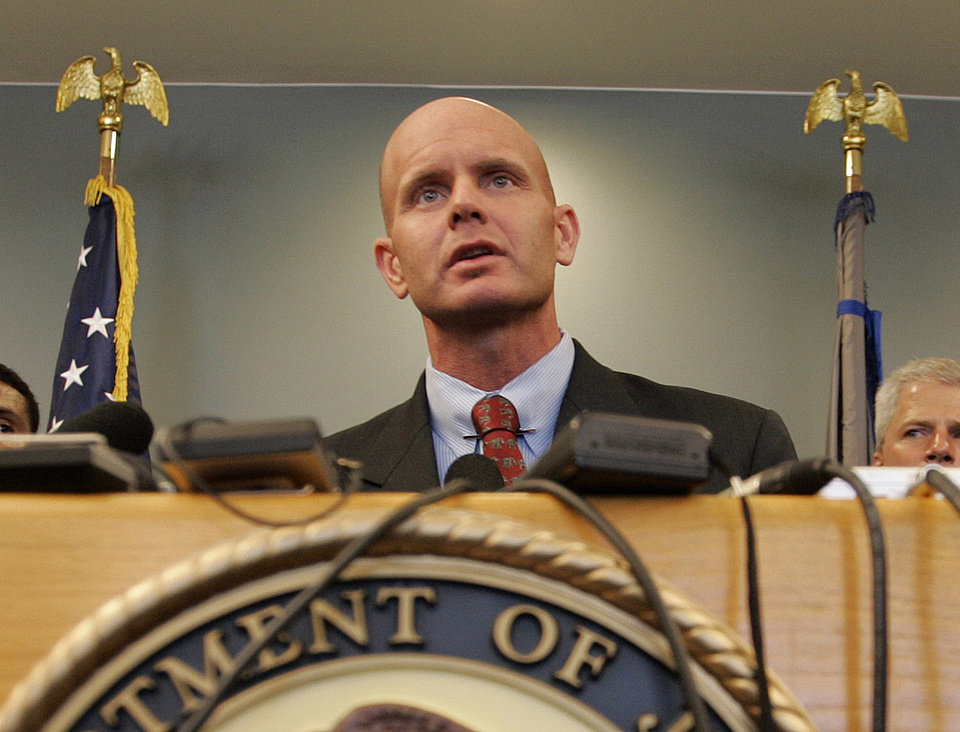 In this July 27, 2005 photo, FBI Agent Frederick Humphries speaks during a news conference after the sentencing of Ahmed Ressam at the Federal Courthouse in Seattle. Humphries has been identified as the agent socialite Jill Kelley contacted to complain about harassing emails sent by Gen. David Petraeus\' paramour, Paula Broadwell. (AP Photo/Kevin P. Casey)