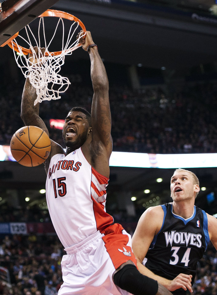 Photo -   CORRECTS RAPTORS PLAYER TO AMIR JOHNSON, NOT ED DAVIS - Toronto Raptors' Amir Johnson, left, dunks past Minnesota Timberwolves center Greg Stiemsma (34) during the first half of their NBA basketball game, Sunday, Nov. 4, 2012, in Toronto. (AP Photo/The Canadian Press, Nathan Denette)