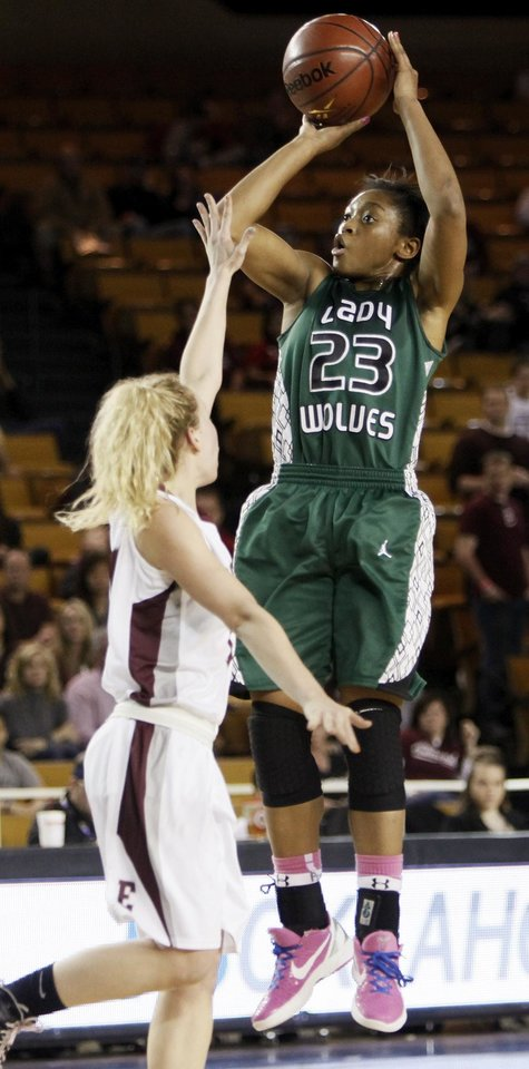 Edmond Santa Fe\'s Courtney Walker (23) shoots over Edmond Memorial\'s Alyssa Hand (14) during the Class 6A girls high school basketball state tournament championship game between Edmond Santa Fe and Edmond Memorial at the Mabee Center in Tulsa, Okla., Saturday, March 10, 2012. Santa Fe won, 44-41. Photo by Nate Billings, The Oklahoman