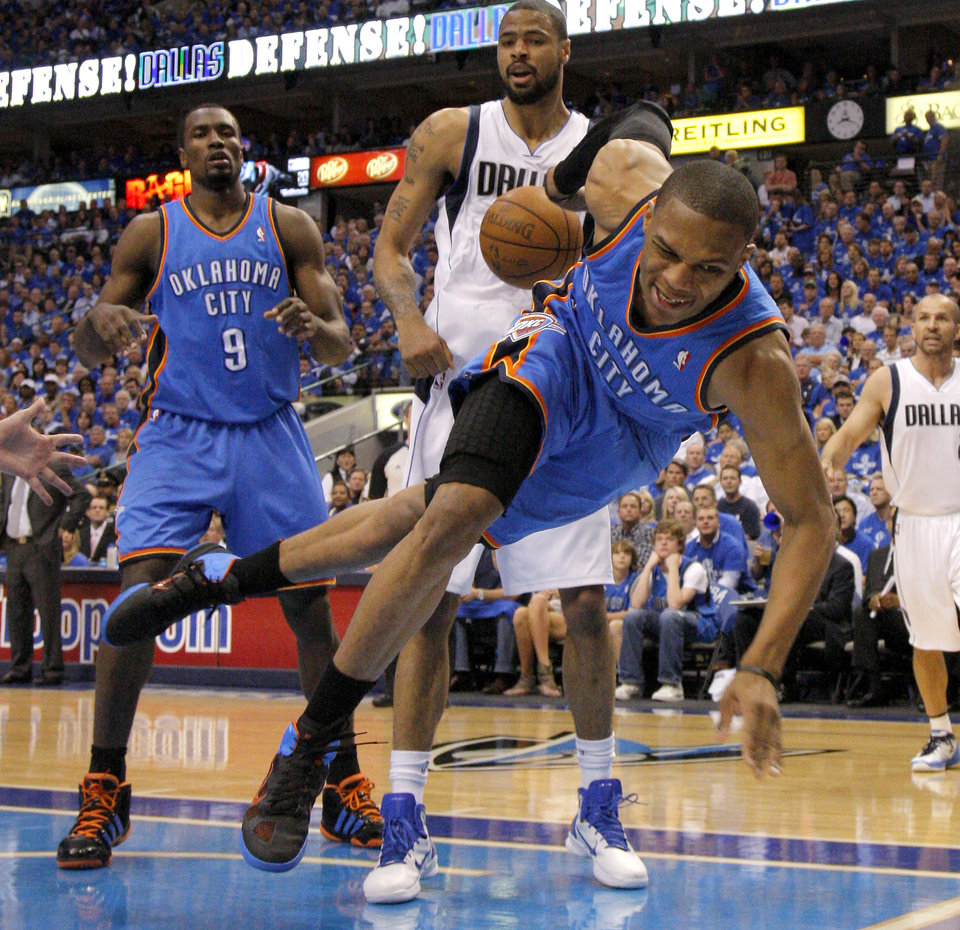Oklahoma City\'s Russell Westbrook (0) leaps to save the ball in front of Tyson Chandler (6) of Dallas and Serge Ibaka (9) during game 5 of the Western Conference Finals in the NBA basketball playoffs between the Dallas Mavericks and the Oklahoma City Thunder at American Airlines Center in Dallas, Wednesday, May 25, 2011. Photo by Bryan Terry, The Oklahoman ORG XMIT: KOD