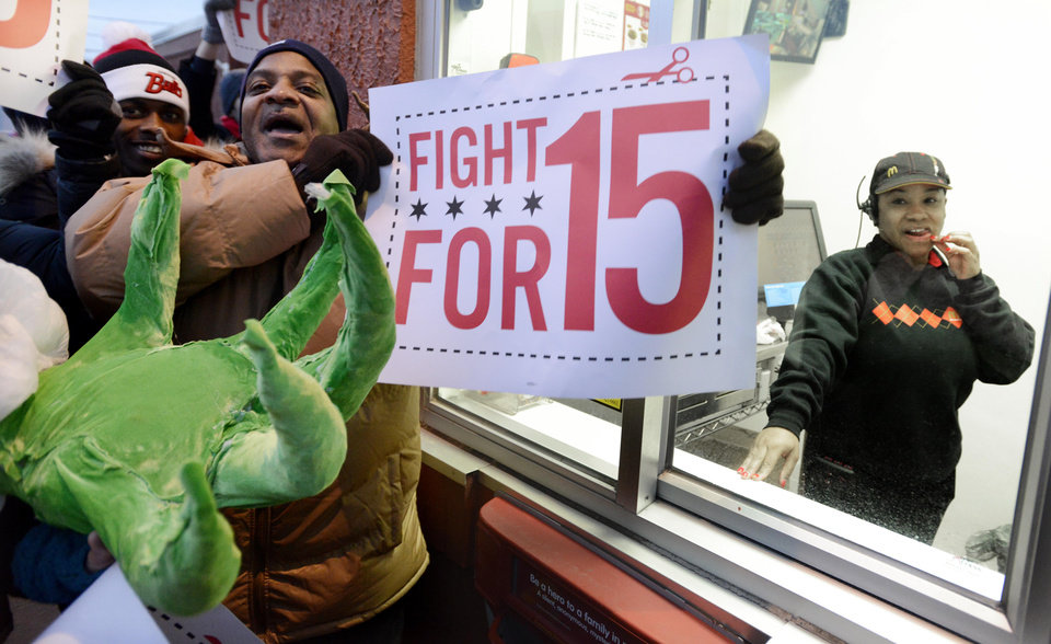 Protesters protest for higher wages outside a McDonalds restaurant in Chicago, Thursday, Dec., 5, 2013. Demonstrations planned in 100 cities are part of a push by labor unions, worker advocacy groups and Democrats to raise the federal minimum wage of $7.25. (AP Photo/Paul Beaty)