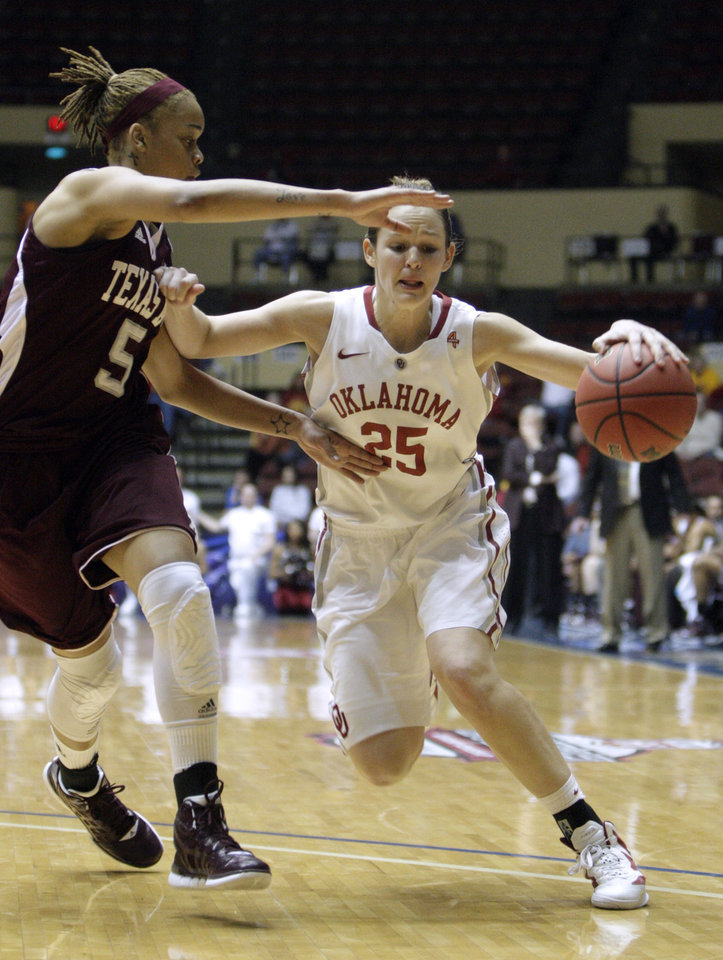 Oklahoma's Whitney Hand (25) tries to get by Texas A&M's Kristi Bellock (5) during the Big 12 tournament women's college basketball game between the University of Oklahoma Sooners and the Texas A&M Aggies at Municipal Auditorium in Kansas City, Mo., Friday, March 9, 2012. Photo by Sarah Phipps, The Oklahoman.