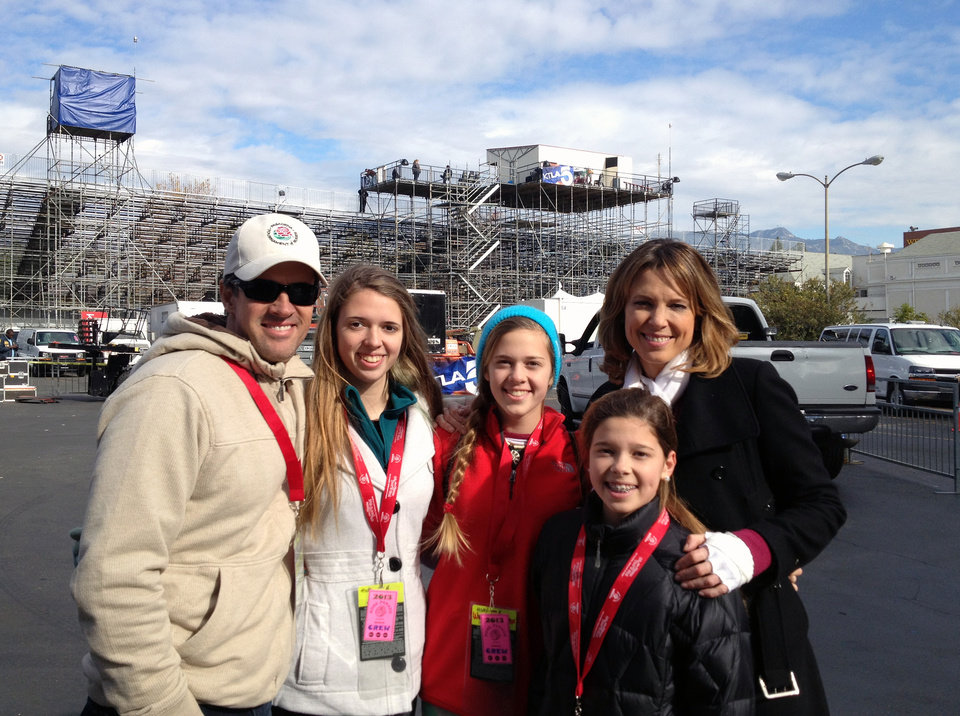 Photo - In this photo provided by Hannah Storm, ESPN anchor Hannah Storm, right, poses for a photo with her family, from left, husband Dan Hicks and daughters Hannah, Ellery and Riley on the parade grounds of the Rose Parade on Tuesday, Jan. 1, 2013, in Pasadena, Calif. Storm hosted the Rose Parade telecast Tuesday in her first on-air appearance since sustaining first- and second-degree burns to her face, hands, chest and neck in a propane gas grill accident Dec. 11. (AP Photo/Courtesy Hannah Storm)