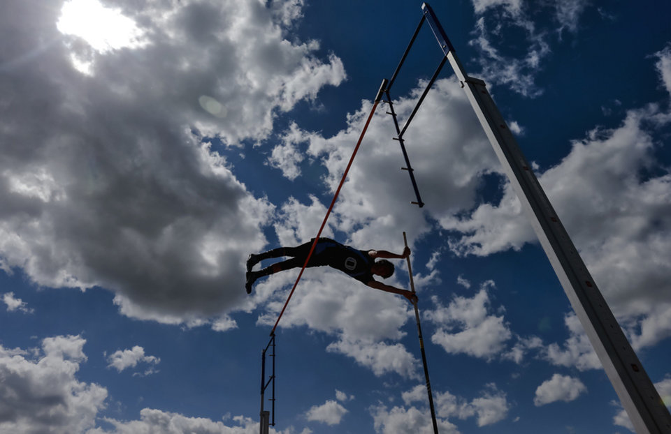 Okeene's Mikey Dobrinski competes in the Class A pole vault during the Class A and 2A state championship track meet at Carl Albert High School on Friday, May 3, 2013, in Midwest City, Okla. Photo by Chris Landsberger, The Oklahoman