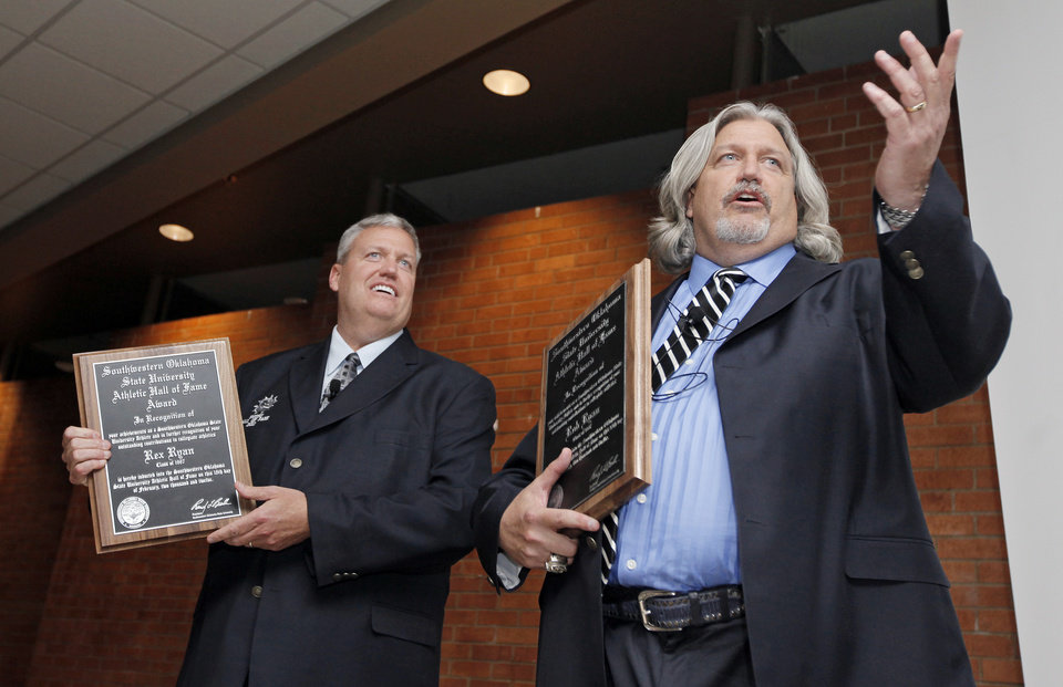 Photo - Rex Ryan, left, and Rob Ryan speak during the banquet to induct the Ryan brothers into the SWOSU Athletics Hall of Fame at Southwestern Oklahoma State University in Weatherford, Okla., Saturday, Feb. 18, 2012. Photo by Nate Billings, The Oklahoman