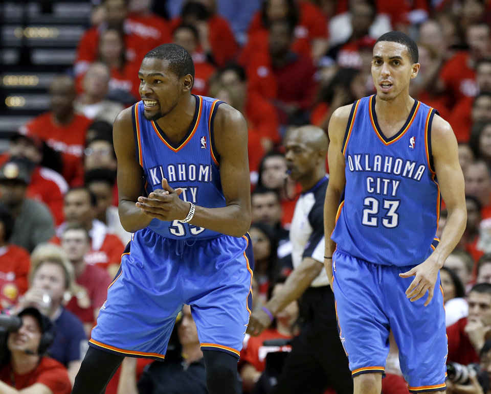 Photo - Oklahoma City's Kevin Durant (35) reacts beside Kevin Martin (23) during Game 6 in the first round of the NBA playoffs between the Oklahoma City Thunder and the Houston Rockets at the Toyota Center in Houston, Texas, Friday, May 3, 2013. Photo by Bryan Terry, The Oklahoman