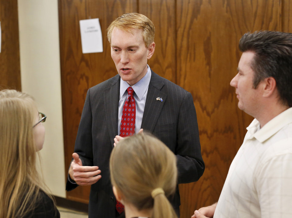 Photo - James Lankford talks to young guests after he and two other Republican candidates for a US Senate seat finished their debate Wednesday, April 16, 2014. Photo by Jim Beckel, The Oklahoman