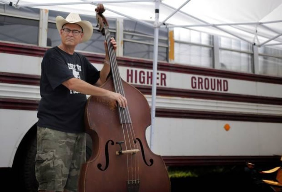 Photo -  Steve Huhn plays music at the campgrounds during the Woody Guthrie Festival in Okemah, Okla., Friday, July 11, 2014. Photo by Sarah Phipps, The Oklahoman