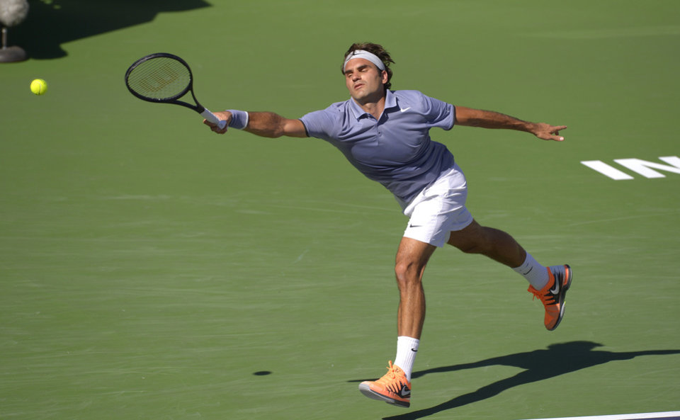 Photo - Roger Federer, of Switzerland, cannot get to a serve from Novak Djokovic, of Serbia, in the final match of the BNP Paribas Open tennis tournament on Sunday, March 16, 2014, in Indian Wells, Calif. (AP Photo/Mark J. Terrill)