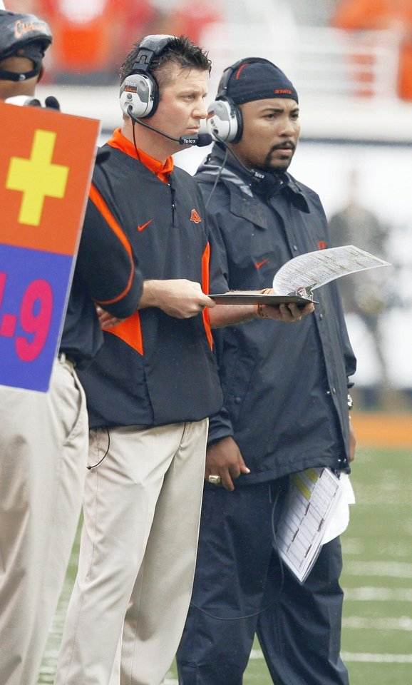 Photo - Mike Gundy, left, may lose another assistant, as Trooper Taylor, right, flew to Auburn on Sunday to speak to Gene Chizik about a job on his staff.  PHOTO BY MATT STRASEN, THE OKLAHOMAN ARCHIVE