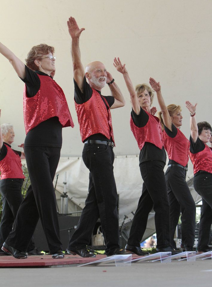 Photo - From left, Marti Hole, Fred Cherry, Mary Burleson, Jan Draper and Sharon Graham with The Okie Stompers perform at the annual May Fair Festival Saturday at Andrews Park in Norman. PHOTO BY STEVE SISNEY, THE OKLAHOMAN  STEVE SISNEY