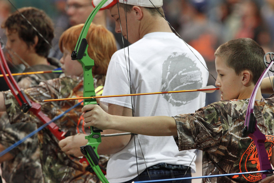 Photo - Jack Gentry, 12, from South Rock Creek School in Shawnee, takes aim during the Oklahoma's National Archery in the Schools Program State Shoot in the Travel and Transportation Building at the State Fair Park, Wednesday, March 27, 2013. Photo By David McDaniel/The Oklahoman