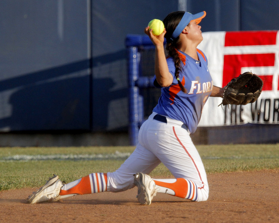 Photo - Florida's Aja Paculba (3) throws to first during the Women's College World Series game between Florida and Alabama at the ASA Hall of Fame Stadium in Oklahoma City, Sunday, June 5, 2011. Photo by Sarah Phipps, The Oklahoman