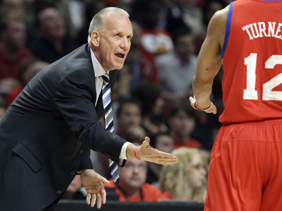 Photo -   Philadelphia 76ers coach Doug Collins congratulates guard Evan Turner (12) after Turner scored during the first quarter of Game 5 in an NBA basketball first-round playoff series against the Chicago Bulls, in Chicago on Tuesday, May 8, 2012. (AP Photo/Nam Y. Huh)