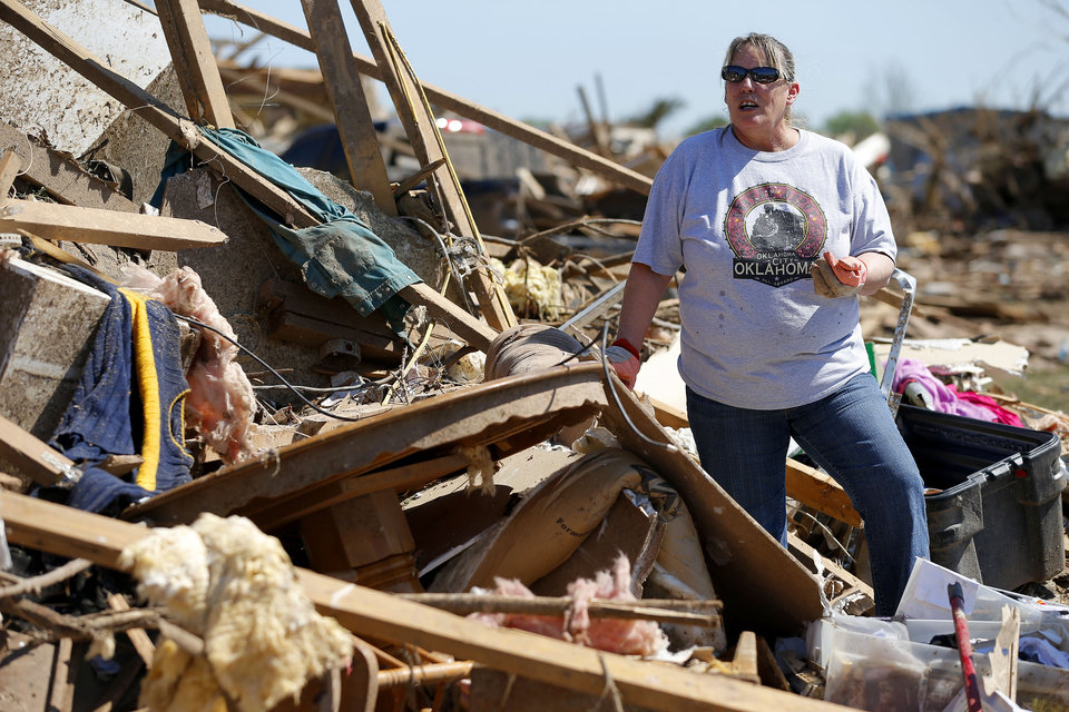 Photo - Pam Dennis searches through what is left of her home on Kings Manor in Moore, Okla., Wednesday, May 22, 2013.A tornado damaged the area on Monday, May 20, 2013. Photo by Bryan Terry, The Oklahoman