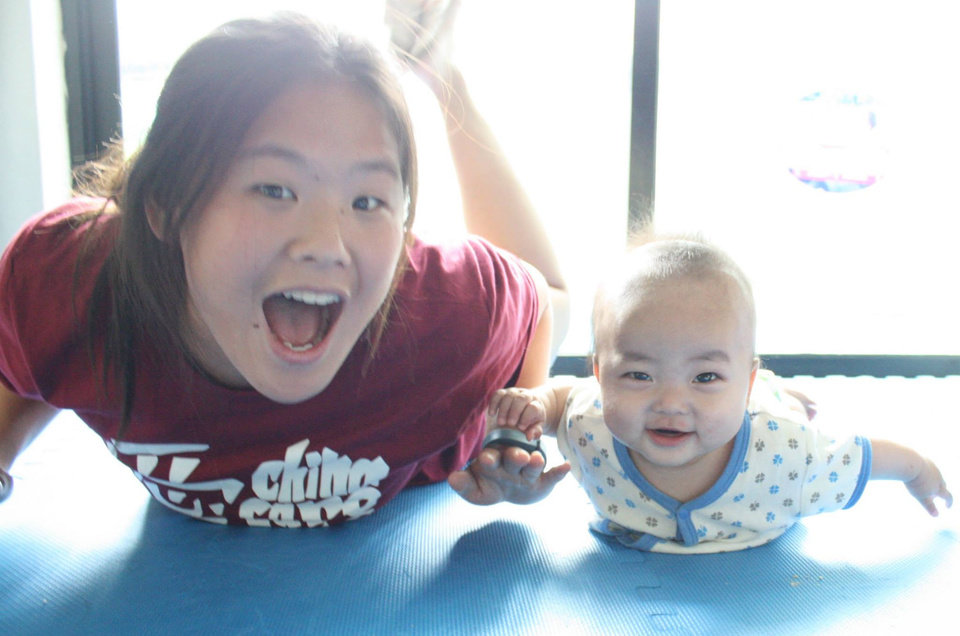 "Photo -  Shaye, a teen participating in a trip to China sponsored by Half the Sky Foundation in partnership with China's Children International, has fun with ""Clark,"" a child living at the China Care Home in Beijing. Photo provided"
